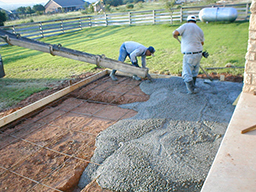 Concrete being poured for the foundation of a spa